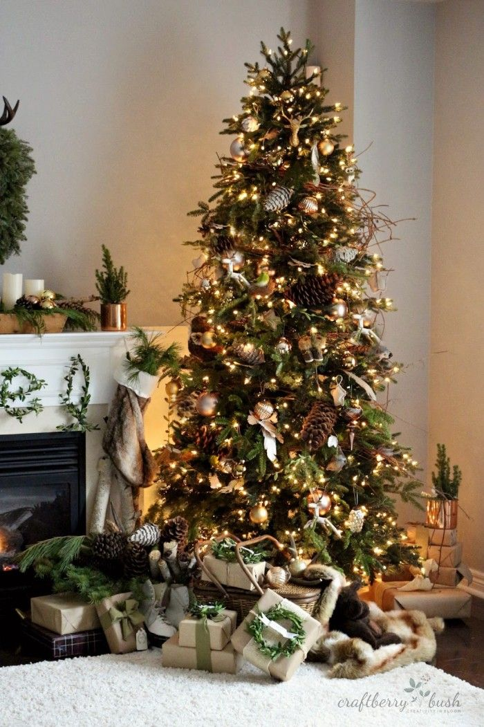 A very woodsy pincecone Christmas Tree! See 10 more Christmas Tree  Decorating Ideas on dreambookdesign.com - 10 Christmas Tree Decorating Ideas Bloggers' Best DIY Ideas