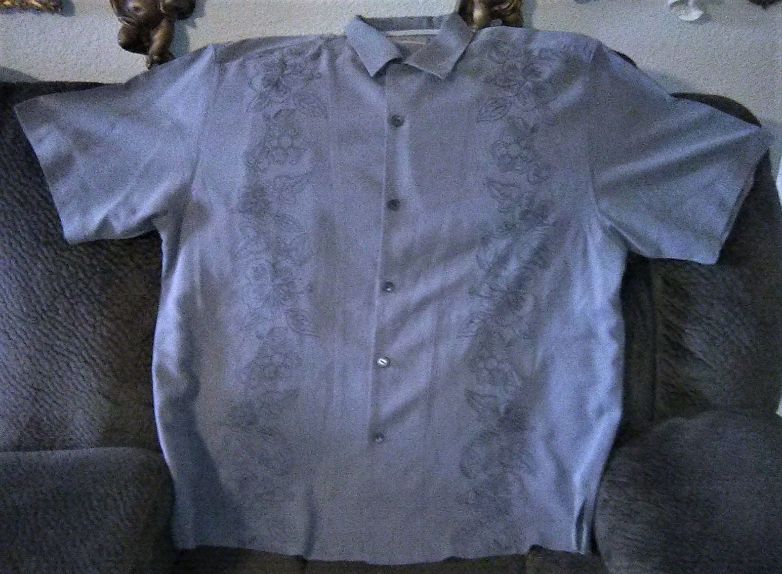 Vintage Tommy Bahamas Men's Vintage Tommy Bahamas Men's Hibiscus Floral Front Full Button Closure La This is such a nice Tommy Bahamas shirt, Size large Men's Hibiscus Floral lined down the front. Guayabera style summer time tropical shirt. Hemmed short sleeves. Grey charcoal ash color. You will love it no snags tears rips or bad smell. non smoker.All sales are final and as-is We list many items daily to our ETSY AND PATTERN SHOPS. Thank you for looking