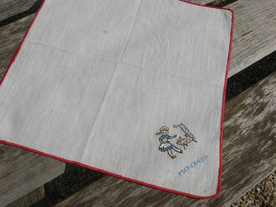 Wednesday Handkerchief, Mercredi Vintage French linen hanky. Hand embroidered, baby sitting or mother and child, red edge. Made in France @PumpjackPiddlewcick on Etsy