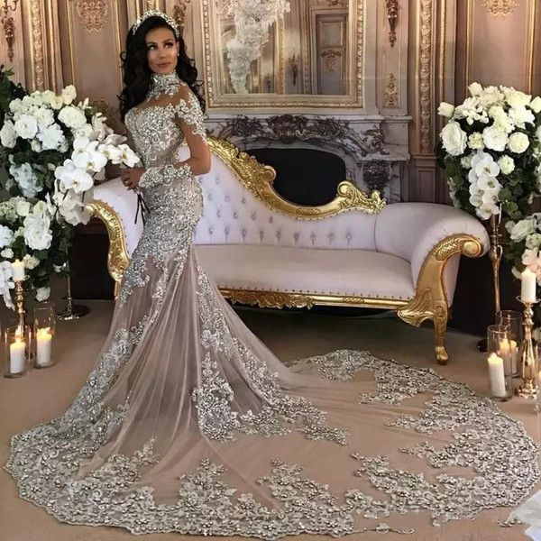 Dubai Arabic Luxury Sparkly 2018 Wedding Dresses Sexy Bling Beaded Lace  Applique High Neck Illusion Long Sleeves Mermaid Chapel Bridal Gowns Corset  Wedding ... d733374a1ab4