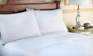 Groupon - Hotel New York Microfiber Embossed Dobby Stripe Sheet Set (Up to 74% Off). Multiple Colors. Free Shipping and Returns. in Online Deal. Groupon deal price: $17.99