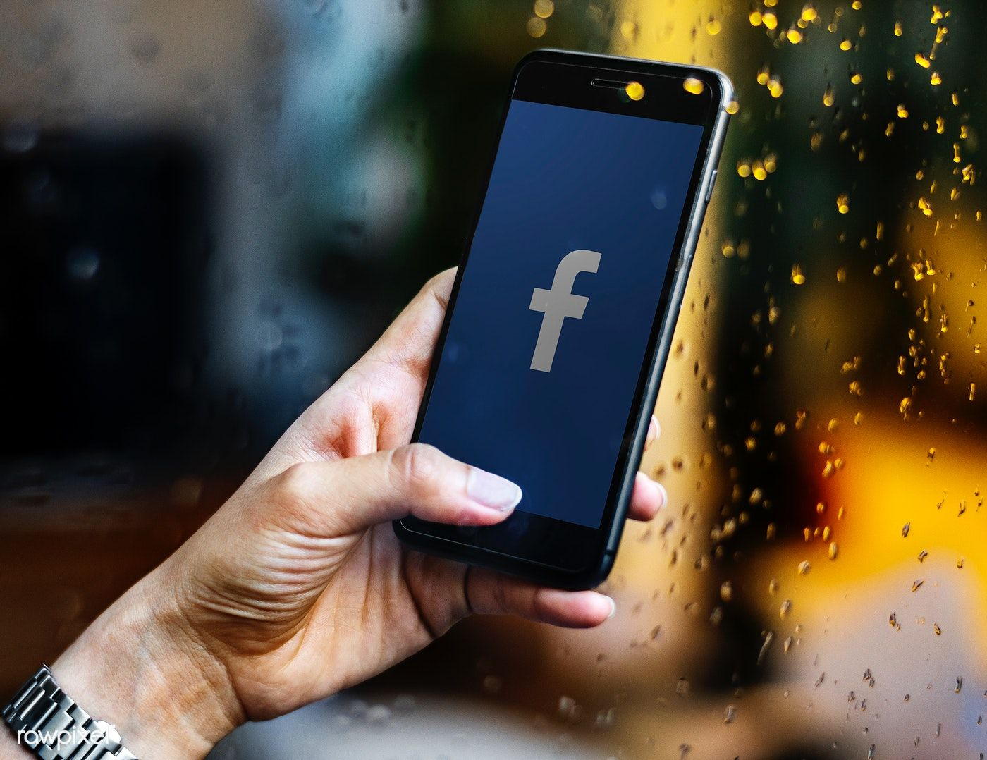 Person using Facebook application on a phone | free image by