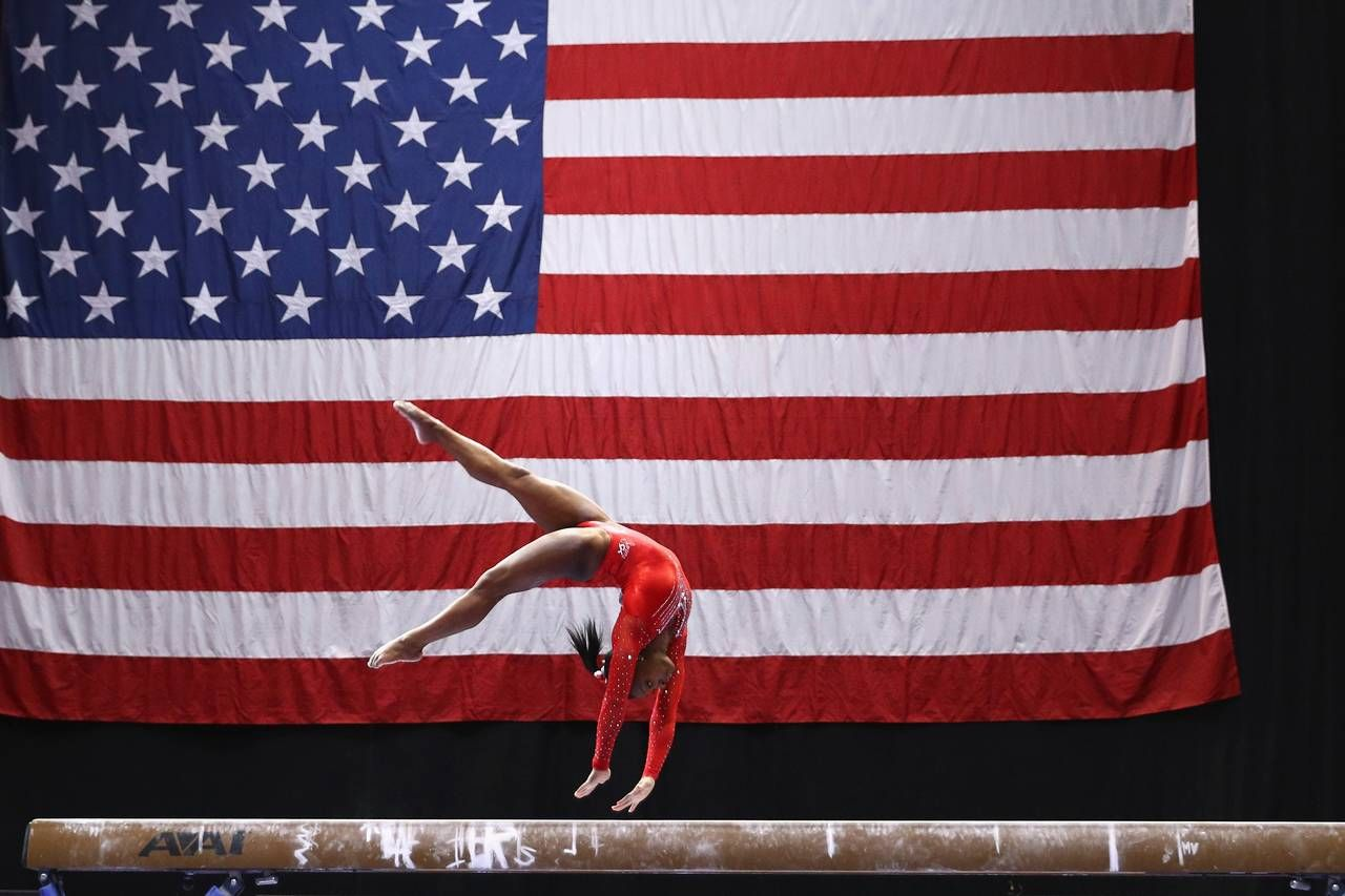 Simone Biles competes on the balance beam during the Sr. Women's 2016 Secret U.S. Classic at the XL Center on June 4...