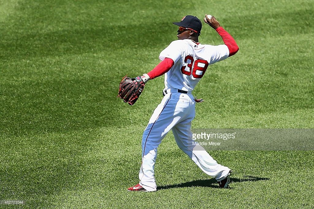 Rusney Castillo #38 of the Boston Red Sox throws towards first during the third inning against the Tampa Bay Rays at Fenway Park on August 2, 2015 in Boston, Massachusetts.
