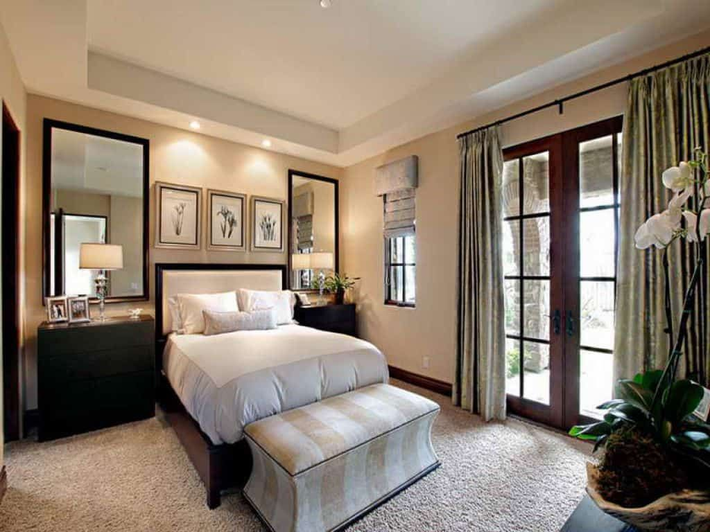 Cool Guest Bedroom With Mirrors Over Nightstands And Ottoman | bedrooms in 2019 | Guest bedroom ...