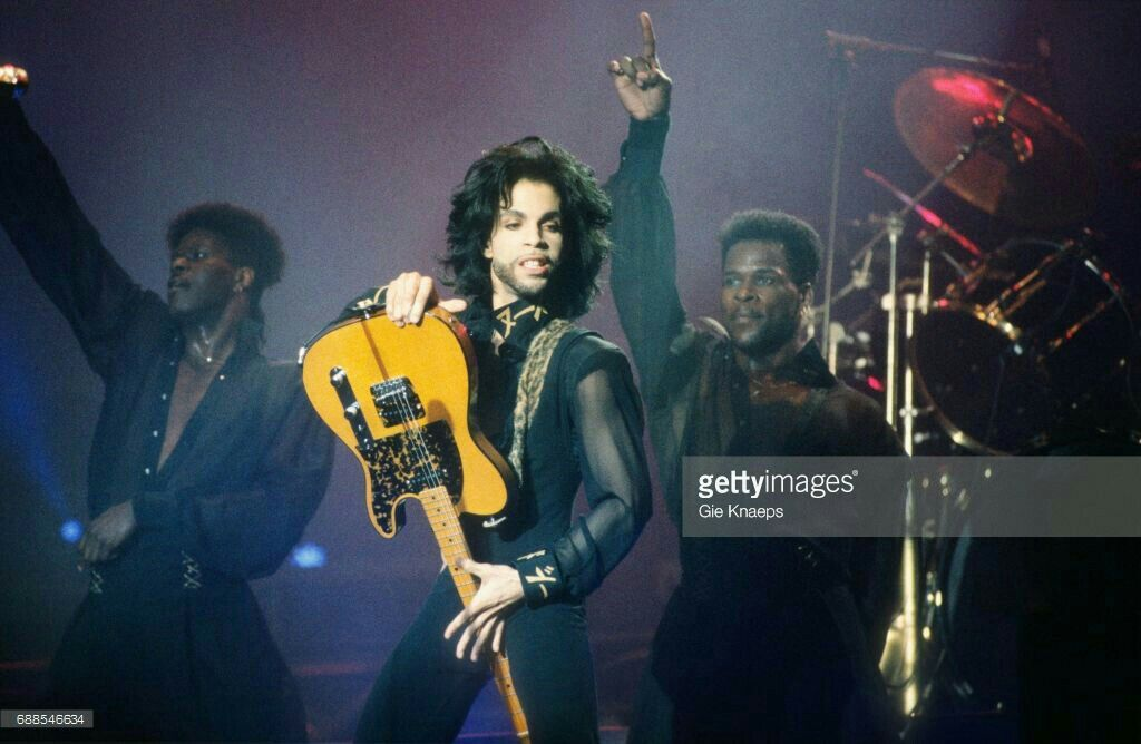 Prince performs during the Purple Rain Tour at the St. Paul Civic News Photo - Getty Images