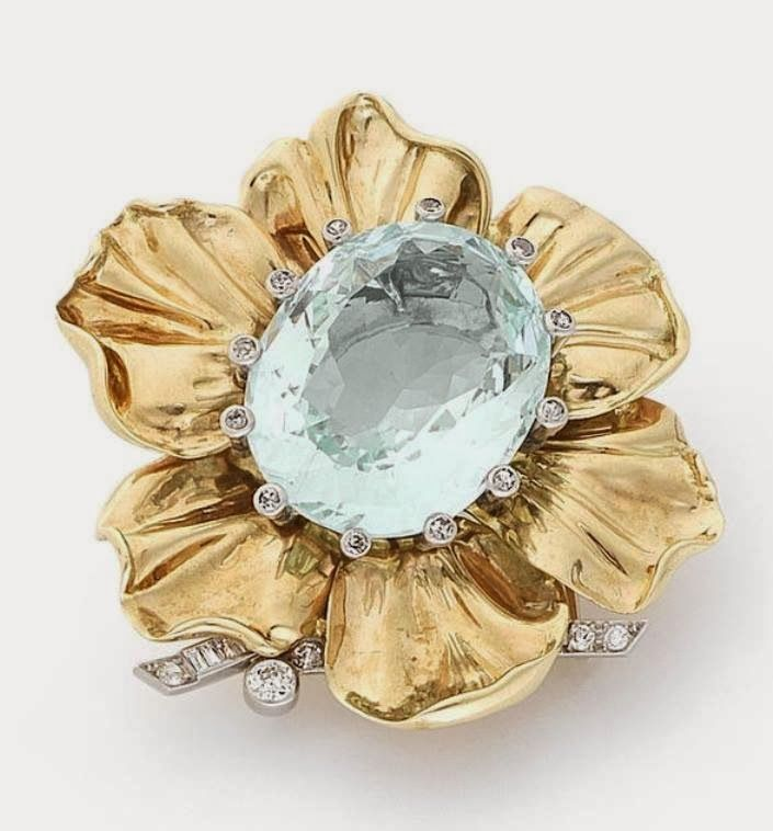 An aquamarine and diamond flower clip, by Cartier, circa 1950 The oval-cut aquamarine within a single-cut diamond claw setting, surrounded by polished petals, with brilliant, baguette and single-cut diamond foliate detail, aquamarine approximately 29.50 carats