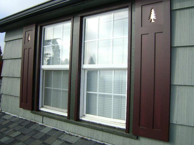 Arts and Crafts shutters with copper-backed pine tree cutouts ...