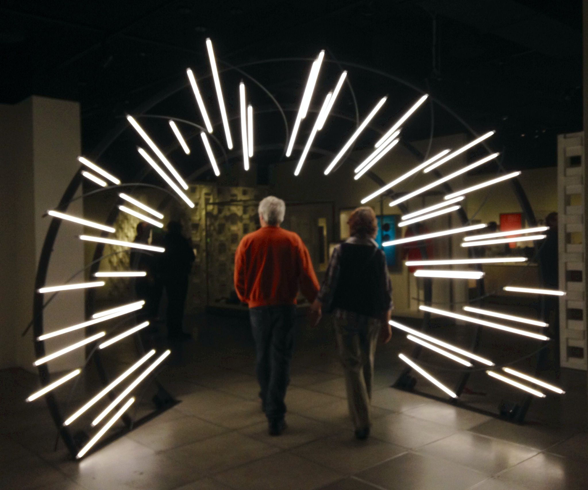 Tunnel of Love: Couple entering the EMP Science Fiction Museum, Seattle #lightartinstallation