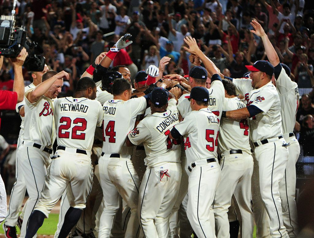 Chipper Jones 10 Of The Atlanta Braves Is Mobbed By Teammates After Hitting A Three Run Walk Off Home Run A Braves Atlanta Braves Baseball Atlanta Braves Game