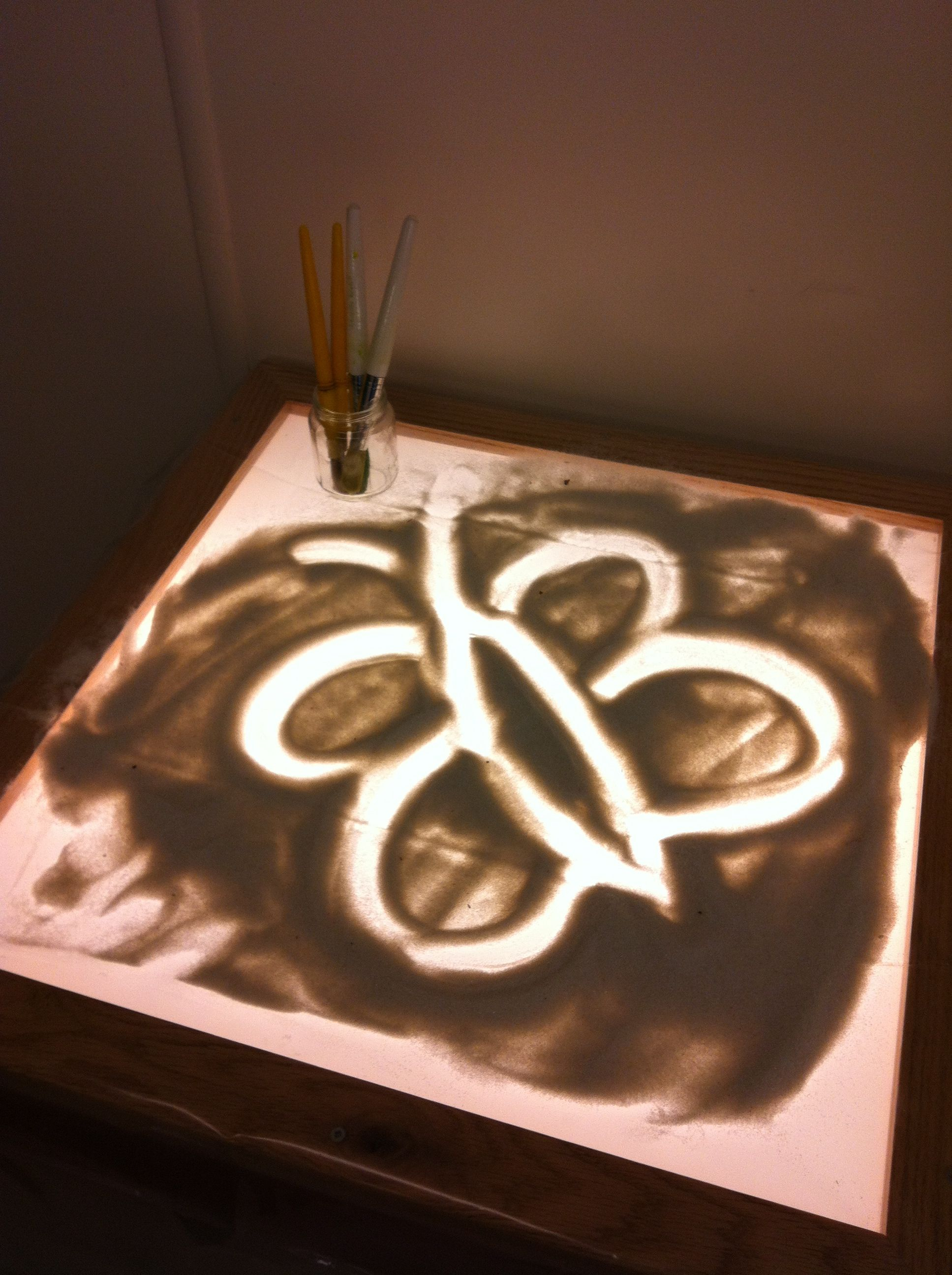 Sand Art On The Light Table Lay A Clear Plastic Cloth Or
