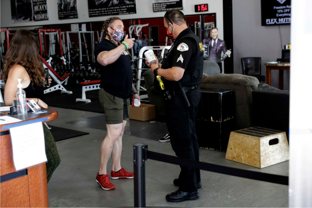 After arrest, gym owner defies California again to reopen