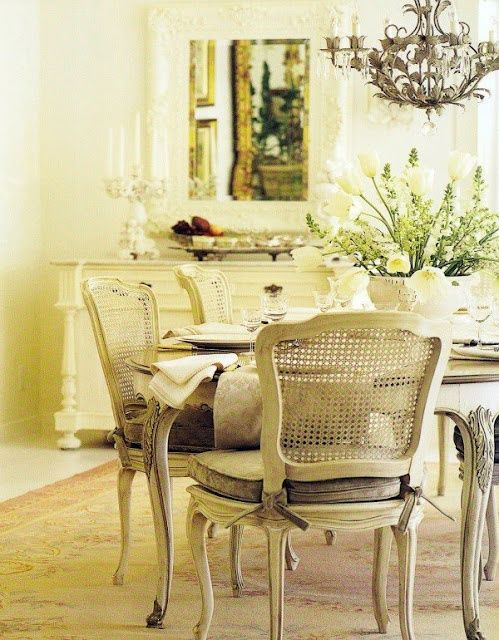 I love the chairs... lovely shabby chic
