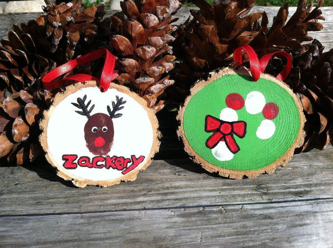DIY fingerprint keepsake wood slice ornaments.