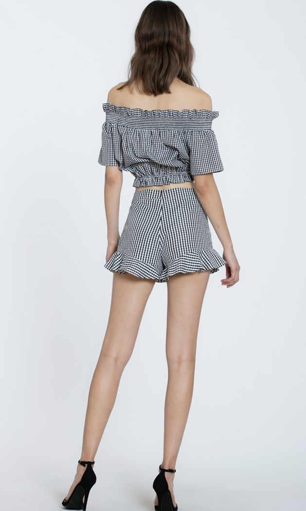 6be52b56023b Two piece gingham set that you can wear together or separate! Off the  shoulder top with bow that ties. High waisted shorts with ruffle detail.