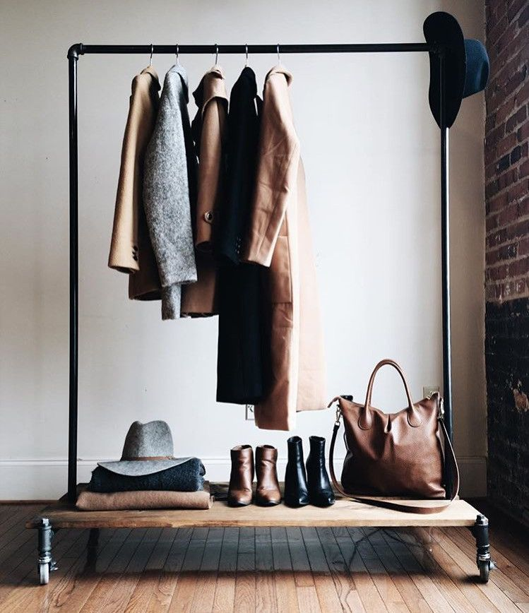 industrial clothing rack with removable wood platforms.  Easy to assemble with no tools.