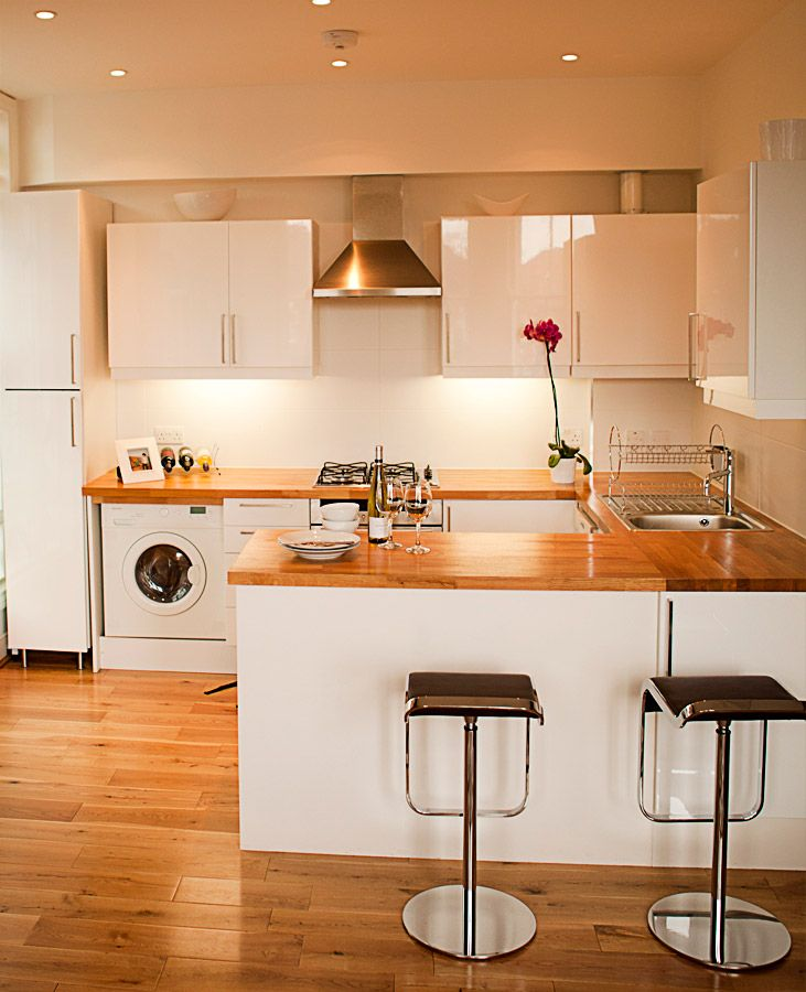 White Painted Wood Floor With Modern Cabinetry: Contemporary White Kitchen Offset