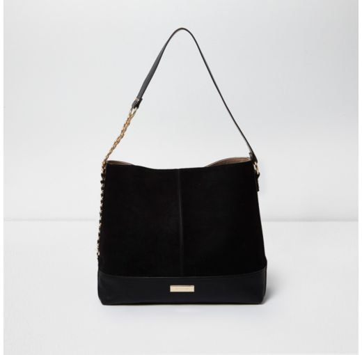 892625ee1d028 Checkout this Black chain side slouch bag from River Island