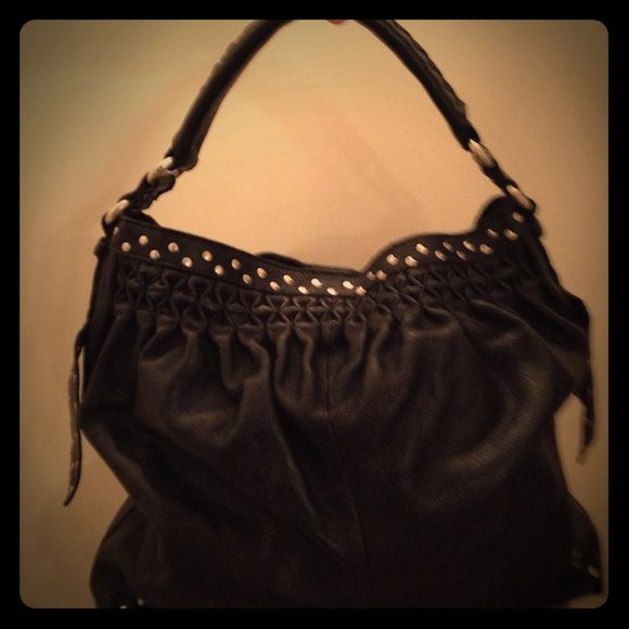 Lucky Brand black leather ruched silver stud hobo Beautiful! ‼️☝ Lightly used,  Lucky Brand  black leather hobo handbag. Ruched leather detail around opening, cute silver stud accents, and distressed silver hardware. Magnetic closure, camo lined inner zippered pocket. Lucky Brand Bags Hobos