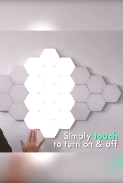 Use this modular touch screen wall light. This design allows the user to effectively slide where they want or need light, turning the wall into a canvas and using their hands as a brush.   The combination of modularity and lighting control is equivalent to a product that can be completely customized by the user. This product offers opportunities for lighting solutions specific to each environment.
