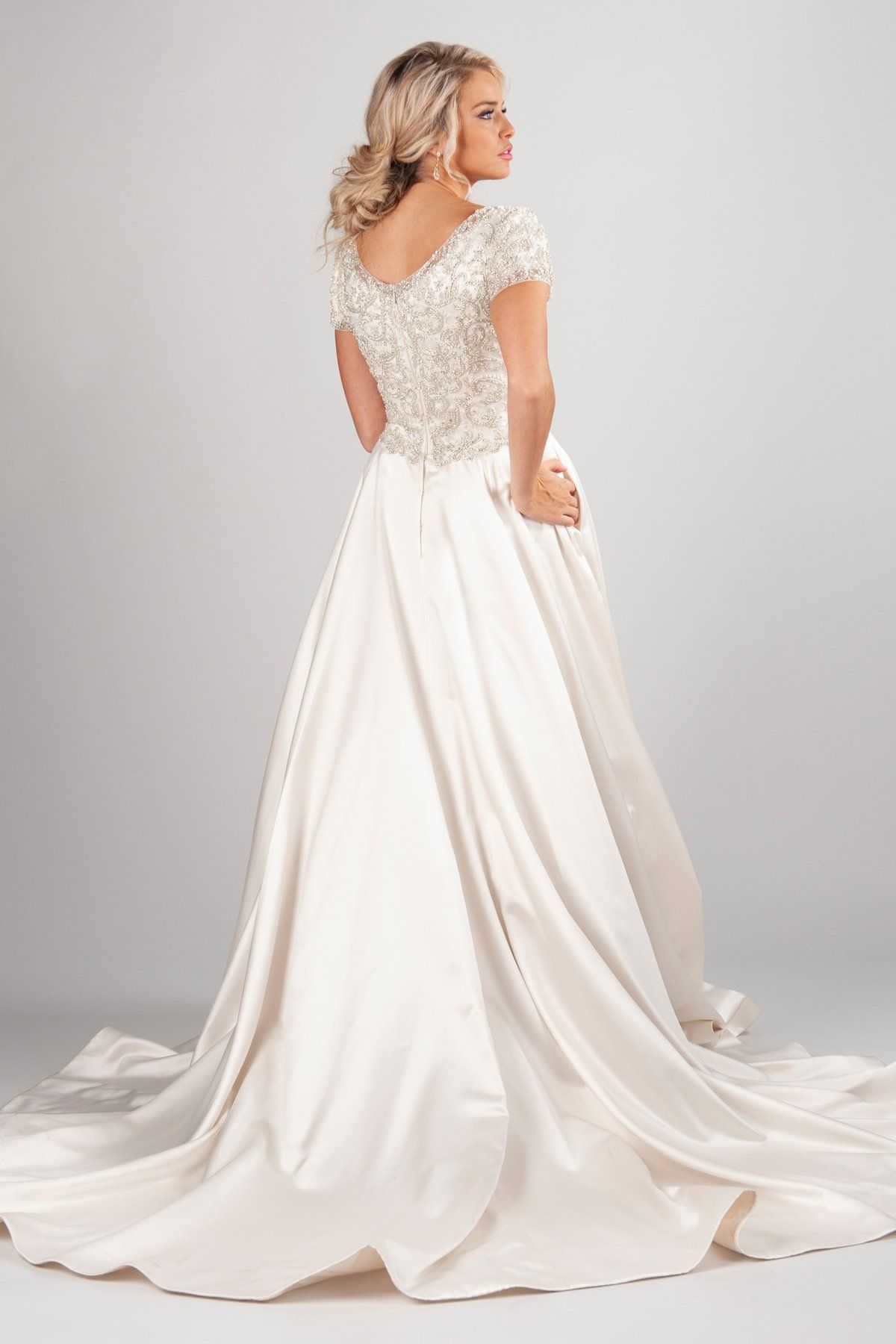 scoop neckline and fully beaded bodice offer the perfect