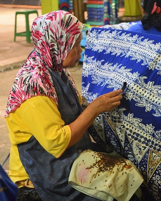 A Local Woman Painstakingly Handcrafts Intricate Batik