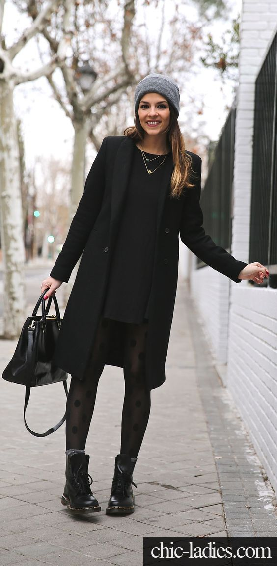 691597a2 Winter Outfits We'd Wear: Natalia Cabezas is wearing a black dress and coat  from Zara, boots from Dr. Martens