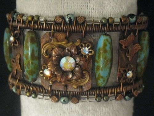Copper cuff bracelet with flowers and butterflies