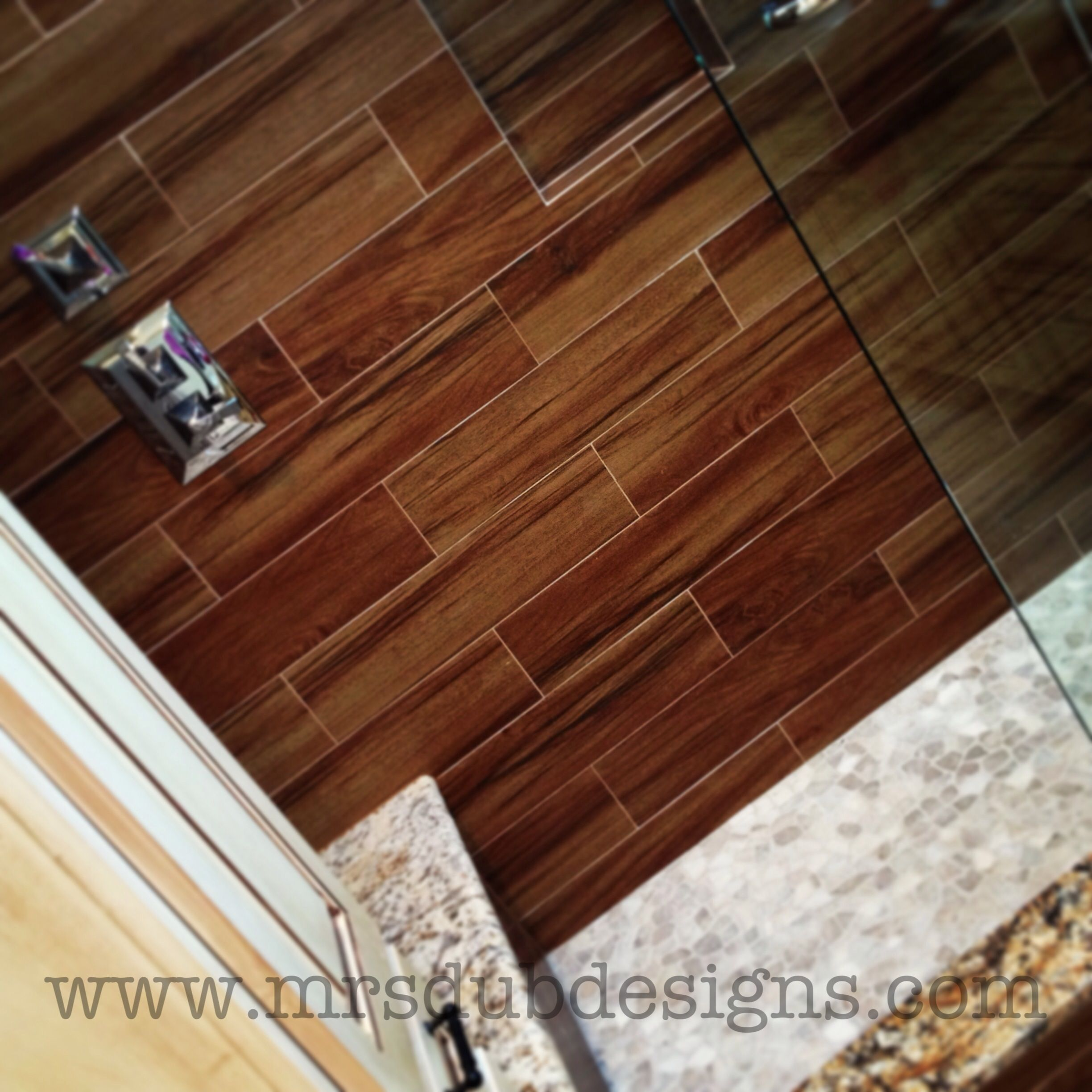 this master bathroom shower features wood grain tile contrasting pebble floor and seamless. Black Bedroom Furniture Sets. Home Design Ideas