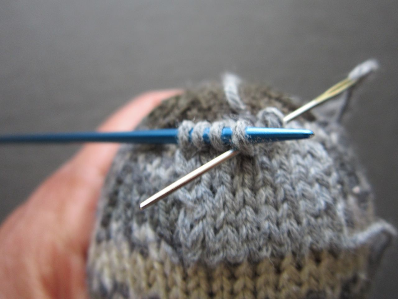 Repairing a handknit sock with a knitinplace patch