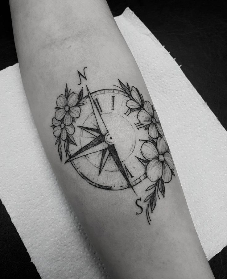 Tattoo Trends – Tattoo created by Marquinho André from Porto Alegre. Compass with flowers of…