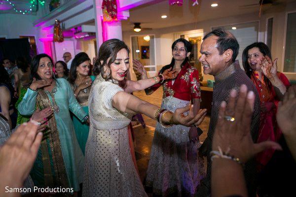 Indian Bride Parents Dancing At Garba Celebration Maharaniweddings
