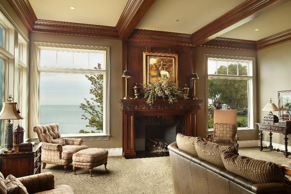 sophisticated living room design  with elegant dark wood fireplace  cost details for this new