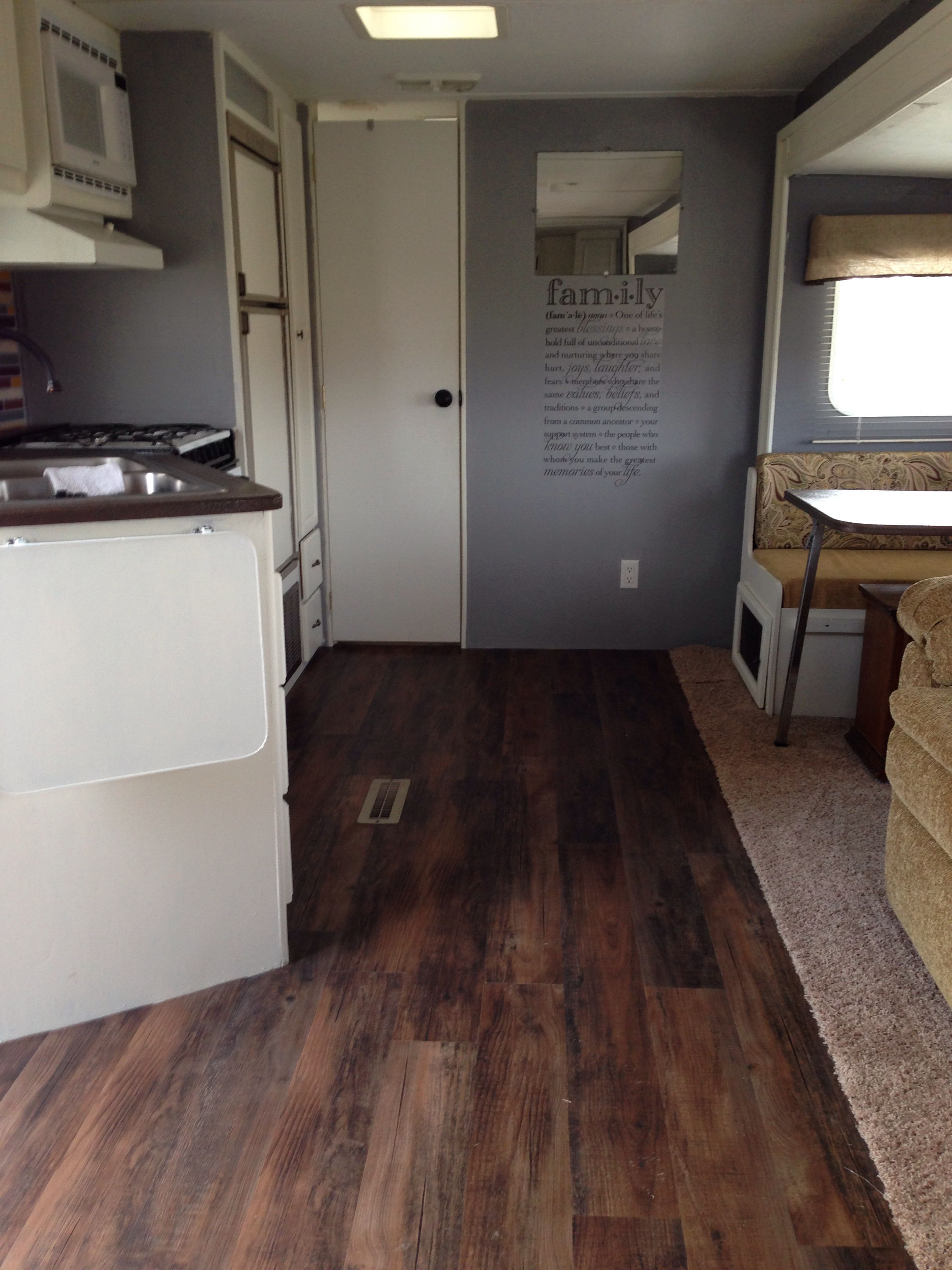 love this camper remodel  love the color and wall decal and the flooring