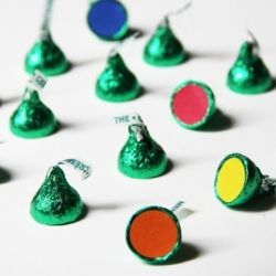 Edible Make-a-Match game!  Use kisses and garage sale dot stickers.  Fun way to group people for games at a fellowship.