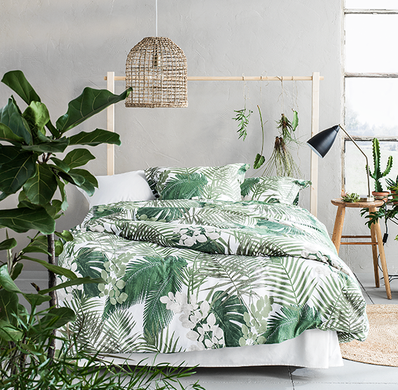 An Exotic Touch To The Bedroom: Fresh Walls And Tropical Palm Bedding