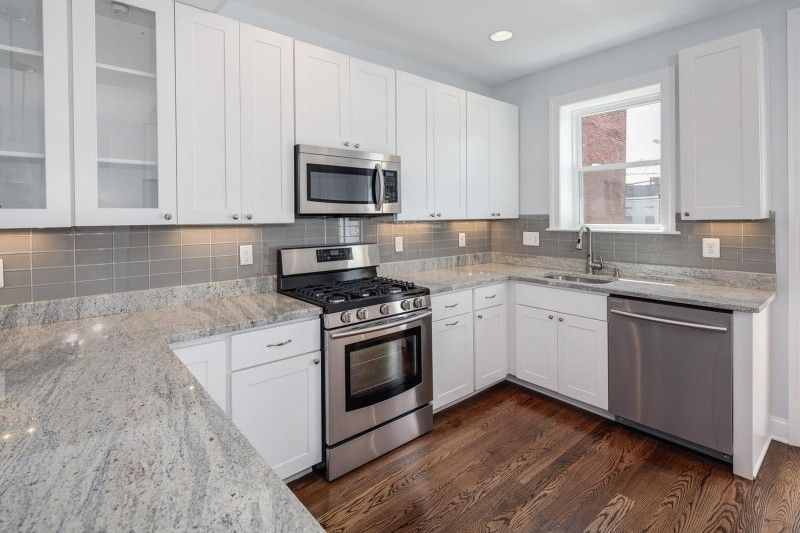 Kitchen White Spring Granite With Tile Backsplash And Modern