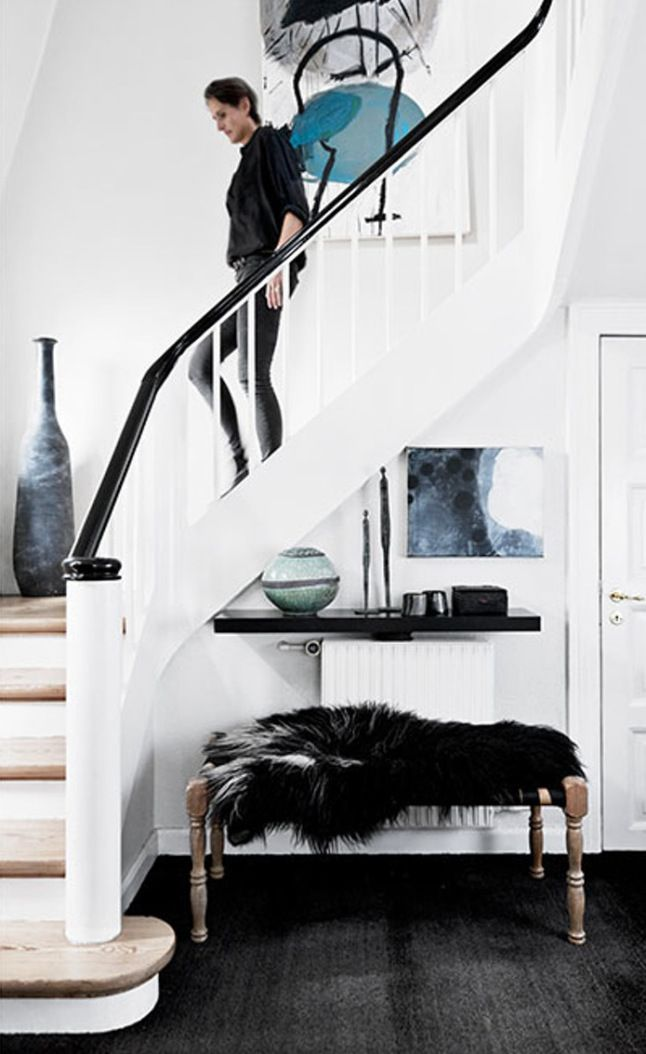 Modern entryway with wooden bench and black faux fur throw ...