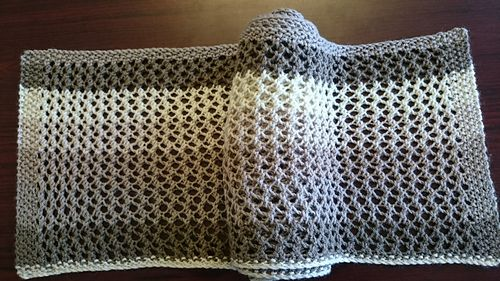 This pretty scarf is made with just one cake of Caron Cakes