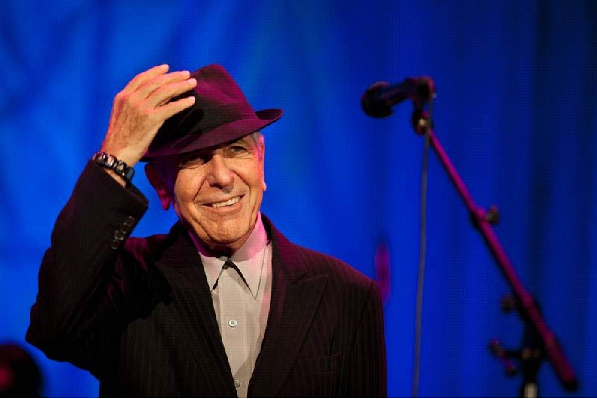 """""""And even though it all went wrong/I'll stand before the Lord of Song/With nothing on my tongue but Hallelujah."""" In concert, Leonard Cohen graciously takes off his hat each time the audience applauds. """"Hallelujah"""" receives the longest ovation. """"Hey, That's No Way To Say Goodbye"""" is also a crowd favorite: """"My love goes with you/As your love stays with me/It's just the way it changes/Like the shoreline and the sea."""""""