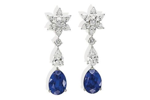A pair of sapphire and diamond earrings by Cartier.