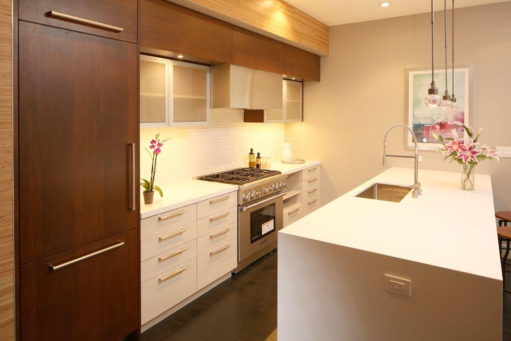 Contemporary Kitchen with Stone Tile, Ultracraft Destiny Broadline Cabinet, Limestone Tile, Breakfast bar, Pendant light