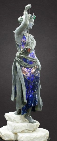 Urania is a sculpture about Divine inspiration. A 6' statue in bronze and stained glass, lit from within. Depicting the celestial muse form John Milton's Paradise Lost, this figure emphasizes the use of formed glass to bring a new dimension of light and color to figure sculpture.