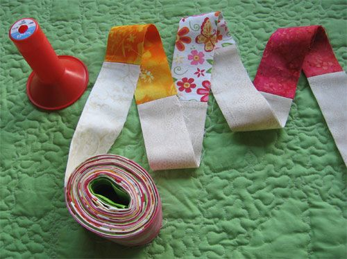 """Fun binding. I do this with my quilt scraps anyway. Is a good way to use up the """"leftovers""""."""
