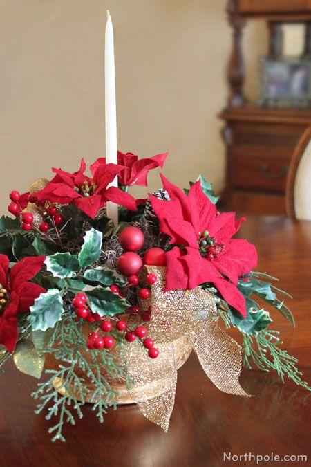 Christmas Table Centerpiece Poinsettia And Taper Candle Christmas Table Centerpieces Christmas Flower Arrangements Christmas Flowers