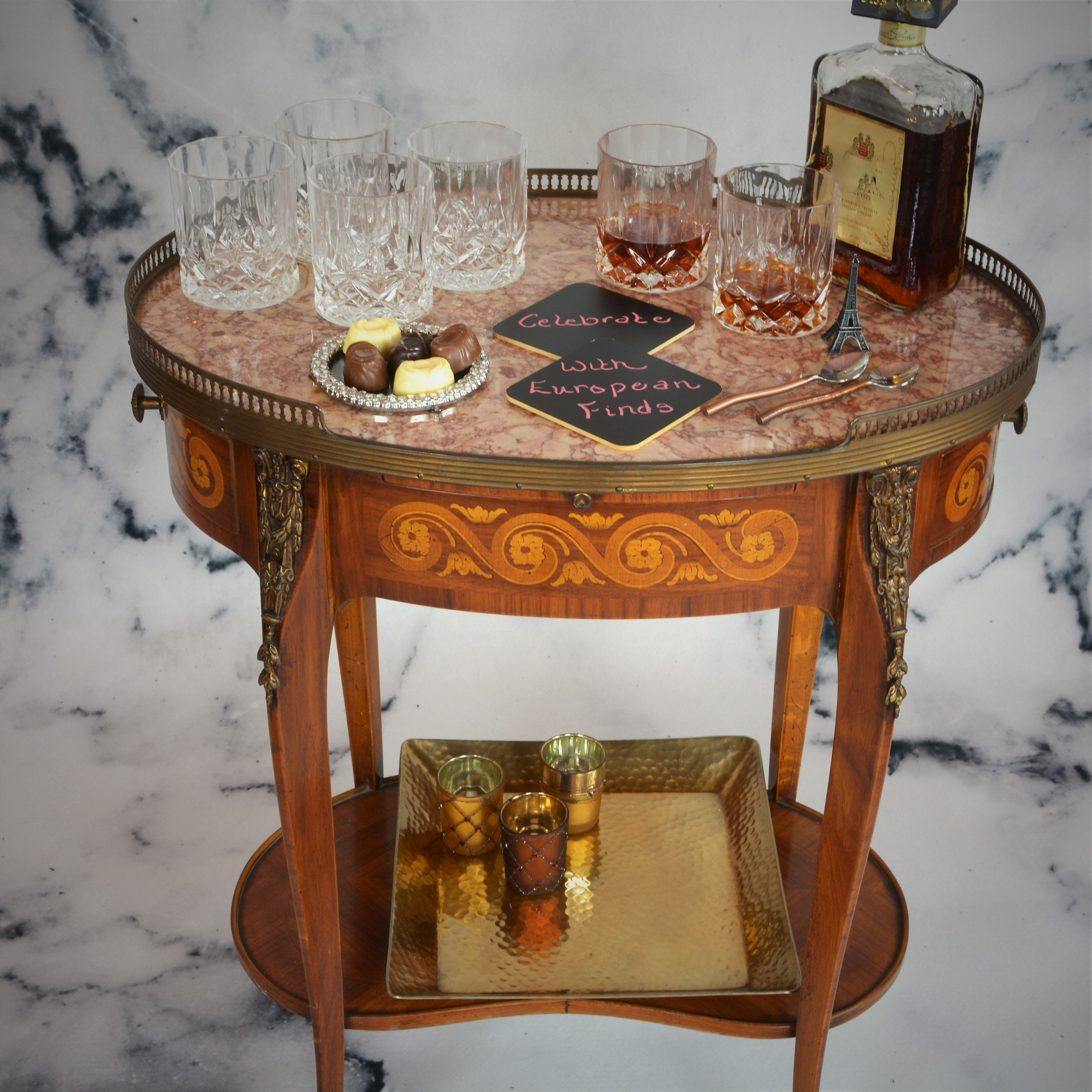 This antique French side table works perfect as a bar cart ...