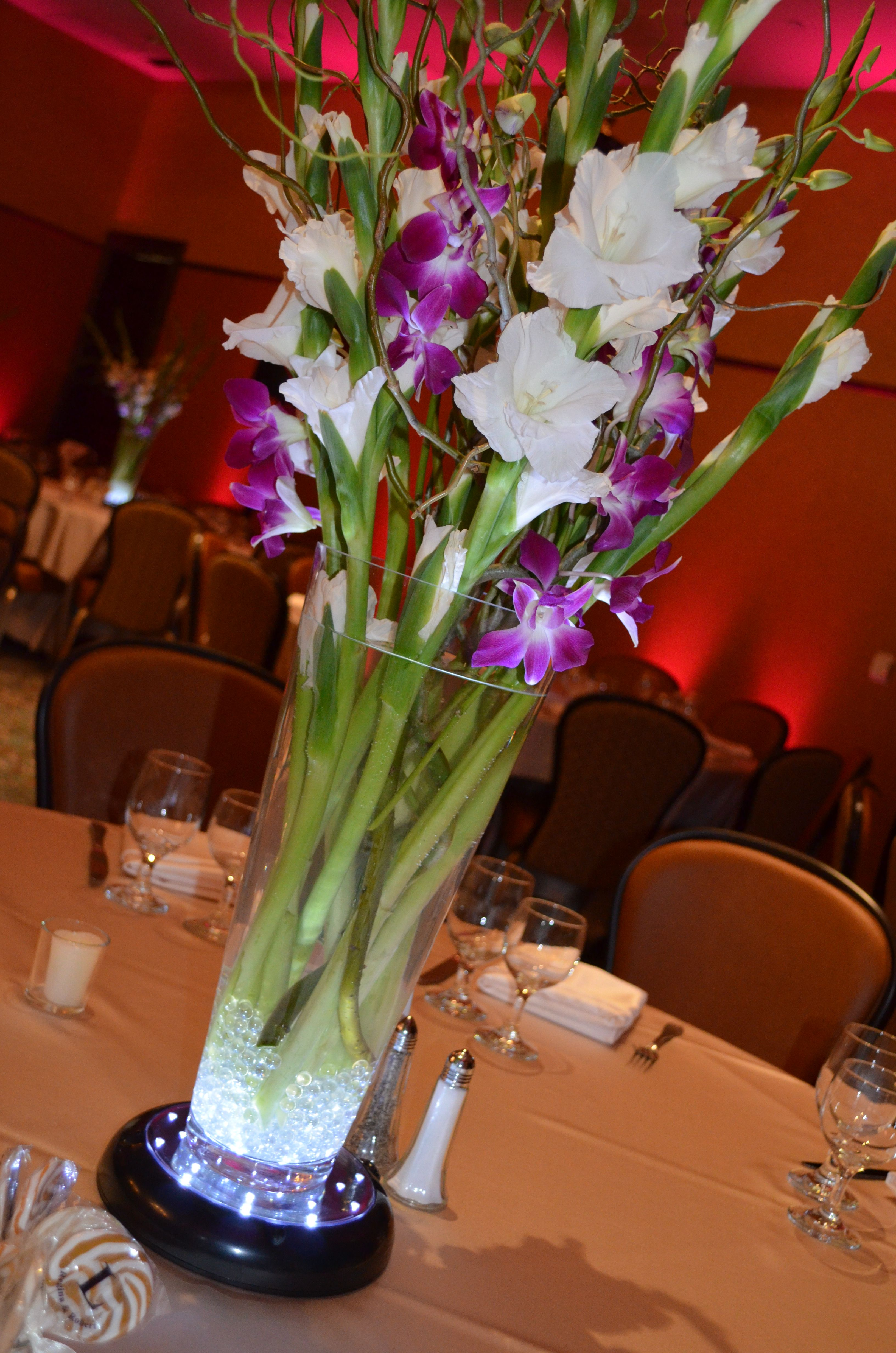 White gladiolus curly willow purple dendrobium orchids