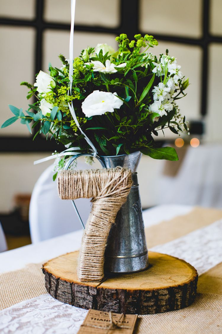 Stylish u relaxed fun white wedding table numbers twine and logs
