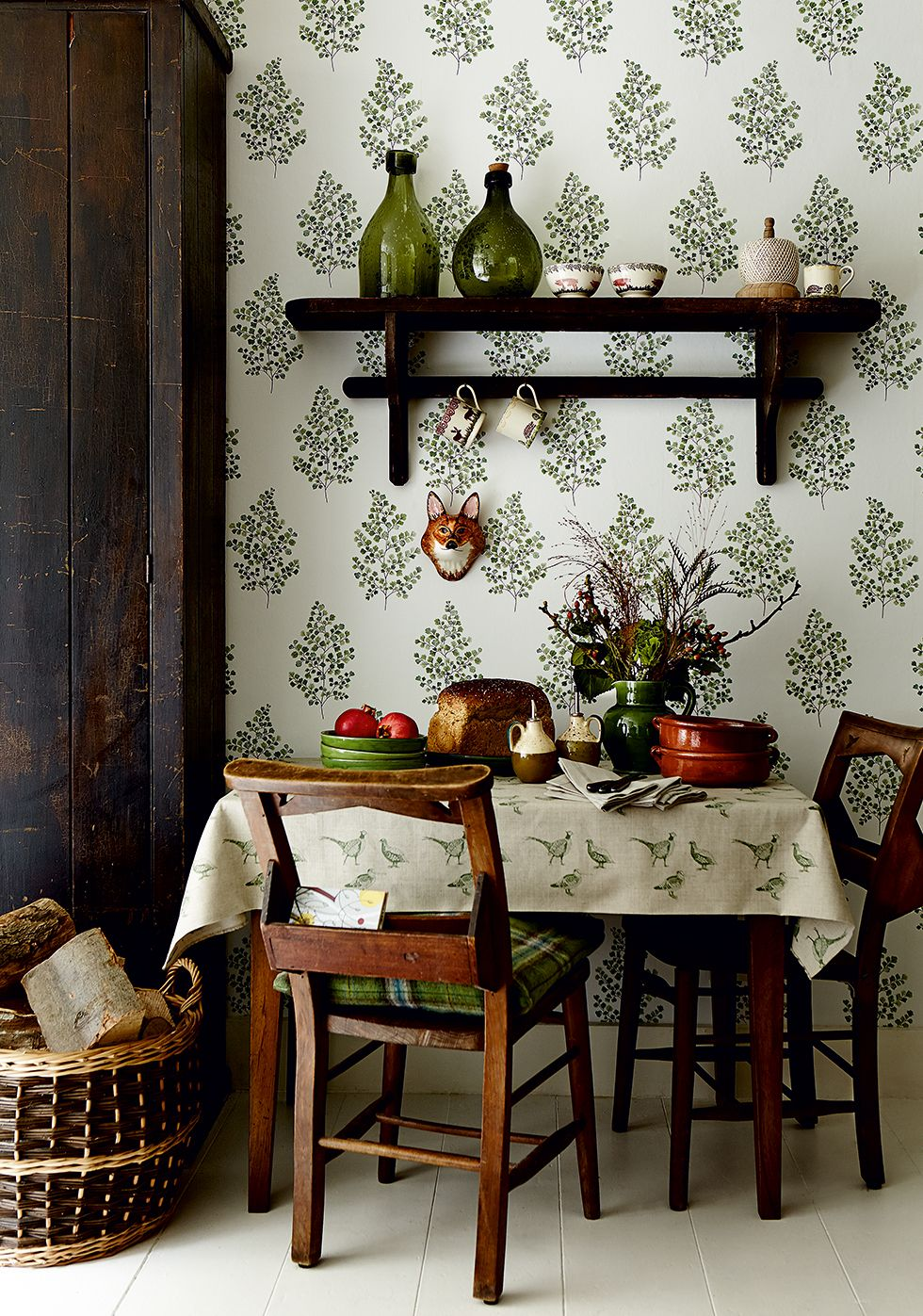 Illustrated botanical wallpaper contrasts with dark wood