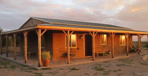 This is a great article by Ross Lukeman that illustrates how simple it really is to make live the life of your dreams despite some major setbacks. Here's how one couple did just that! The picture is of the finished strawbale house they built with their own hands.